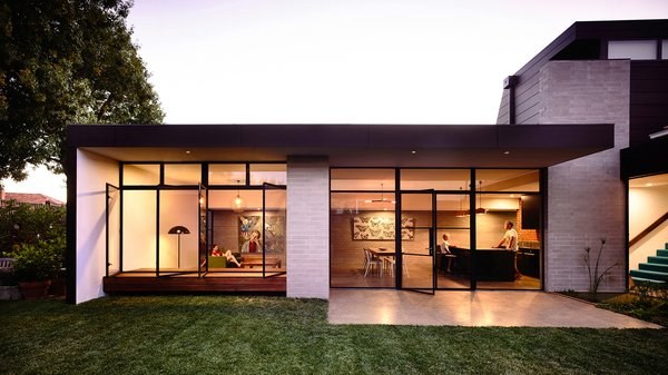 Modern home with outdoor, small patio, porch, deck, back yard, and grass. Photo  of Elwood House