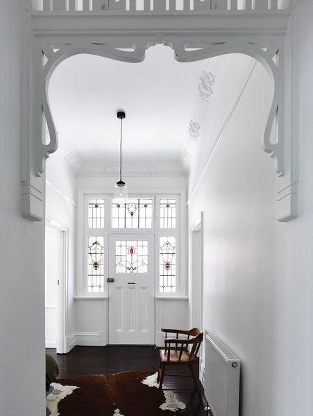 Modern home with hallway and dark hardwood floor. Photo 2 of Elwood House