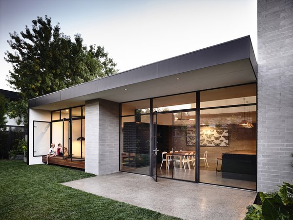 Modern home with outdoor, back yard, and small patio, porch, deck. Photo 3 of Elwood House