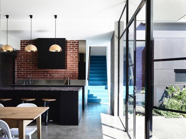 Modern home with kitchen, concrete floor, brick backsplashe, and pendant lighting. Photo 4 of Elwood House