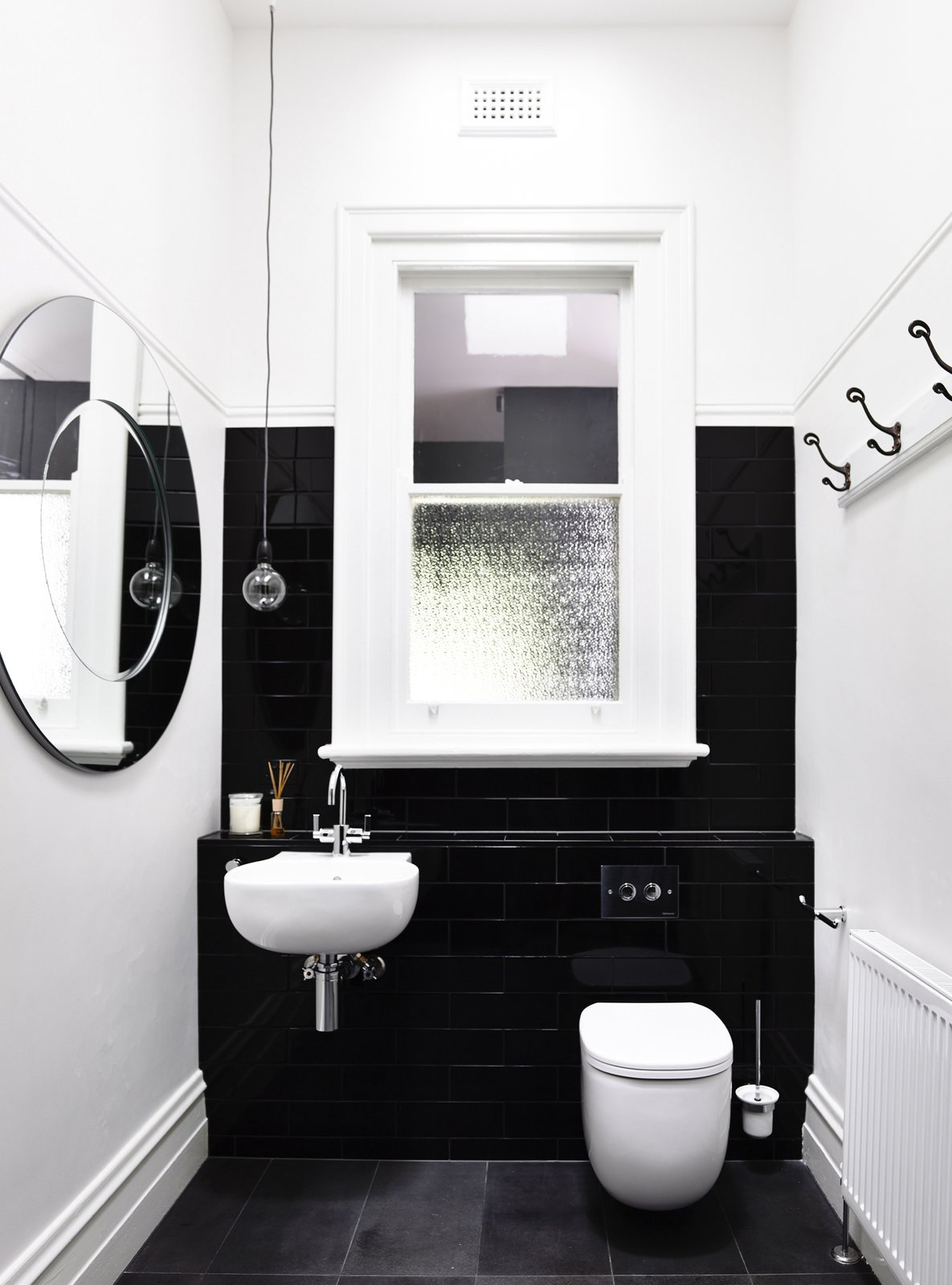 Tagged: Bath Room, Subway Tile Wall, and Wall Mount Sink. Old Meets New in This Modern Extension to an Edwardian House in Melbourne - Photo 4 of 10