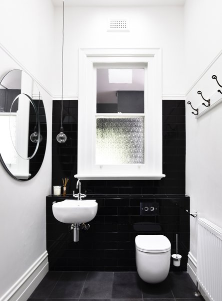 Modern home with bath room, subway tile wall, and wall mount sink. Photo 5 of Elwood House