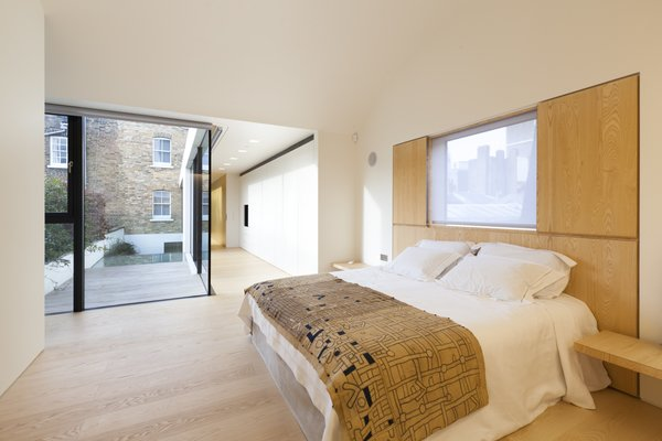 Modern home with bedroom, bed, and light hardwood floor. Photo 8 of Hillgate Street Residence