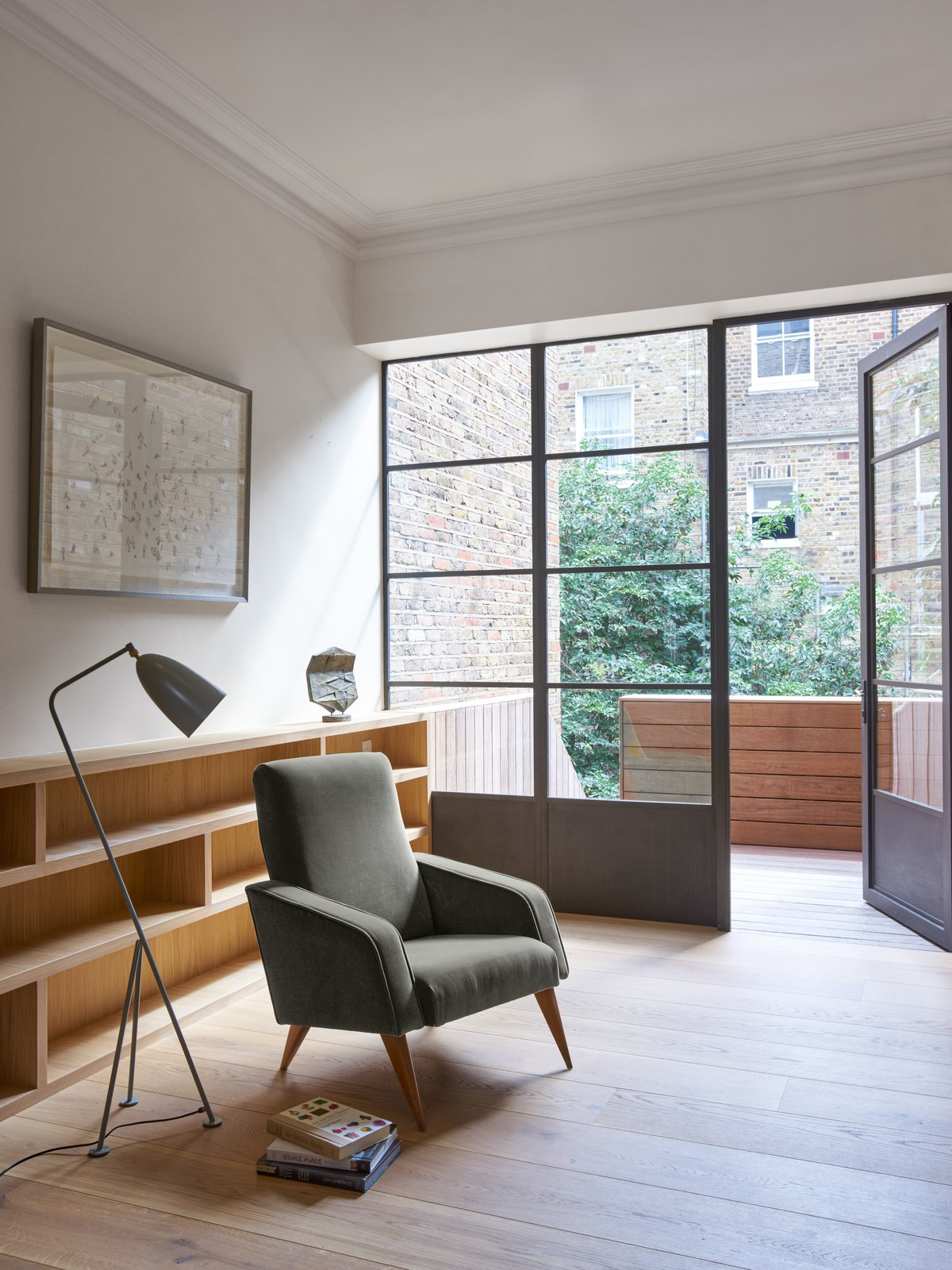 Tagged: Living Room, Chair, and Floor Lighting. A Once-Derelict London House Restored With Modern Elegance - Photo 2 of 10