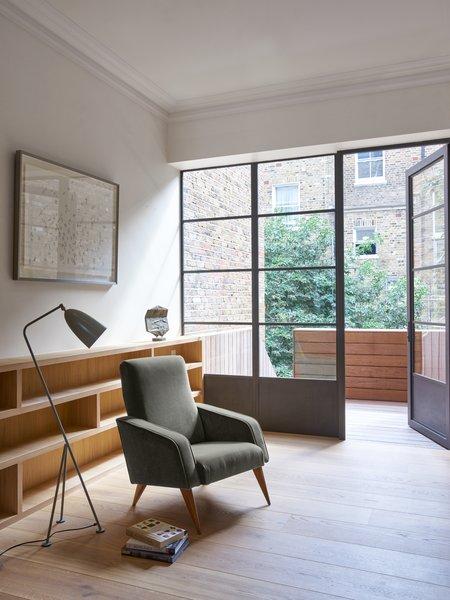 Modern home with living room, chair, and floor lighting. Photo  of Ladbroke Grove