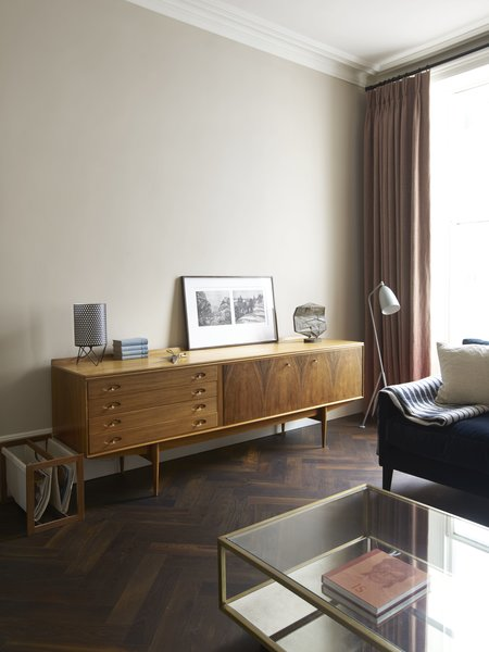 Modern home with living room, chair, console tables, and coffee tables. Photo 6 of Ladbroke Grove