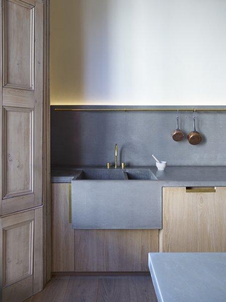 Modern home with kitchen, concrete counter, medium hardwood floor, concrete backsplashe, and undermount sink. Photo 5 of Ladbroke Grove