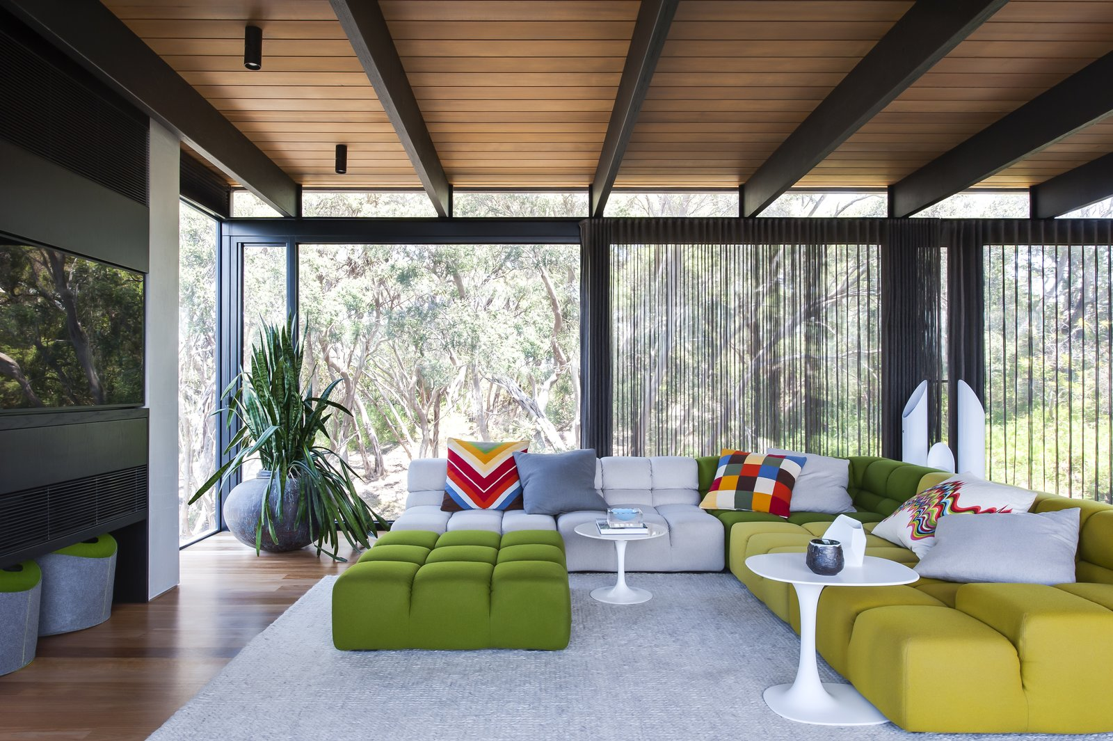 Tagged: Living Room, End Tables, and Sectional.  Photo 1 of 7 in Unexpected Bursts of Color Enliven a Midcentury Pad in Australia