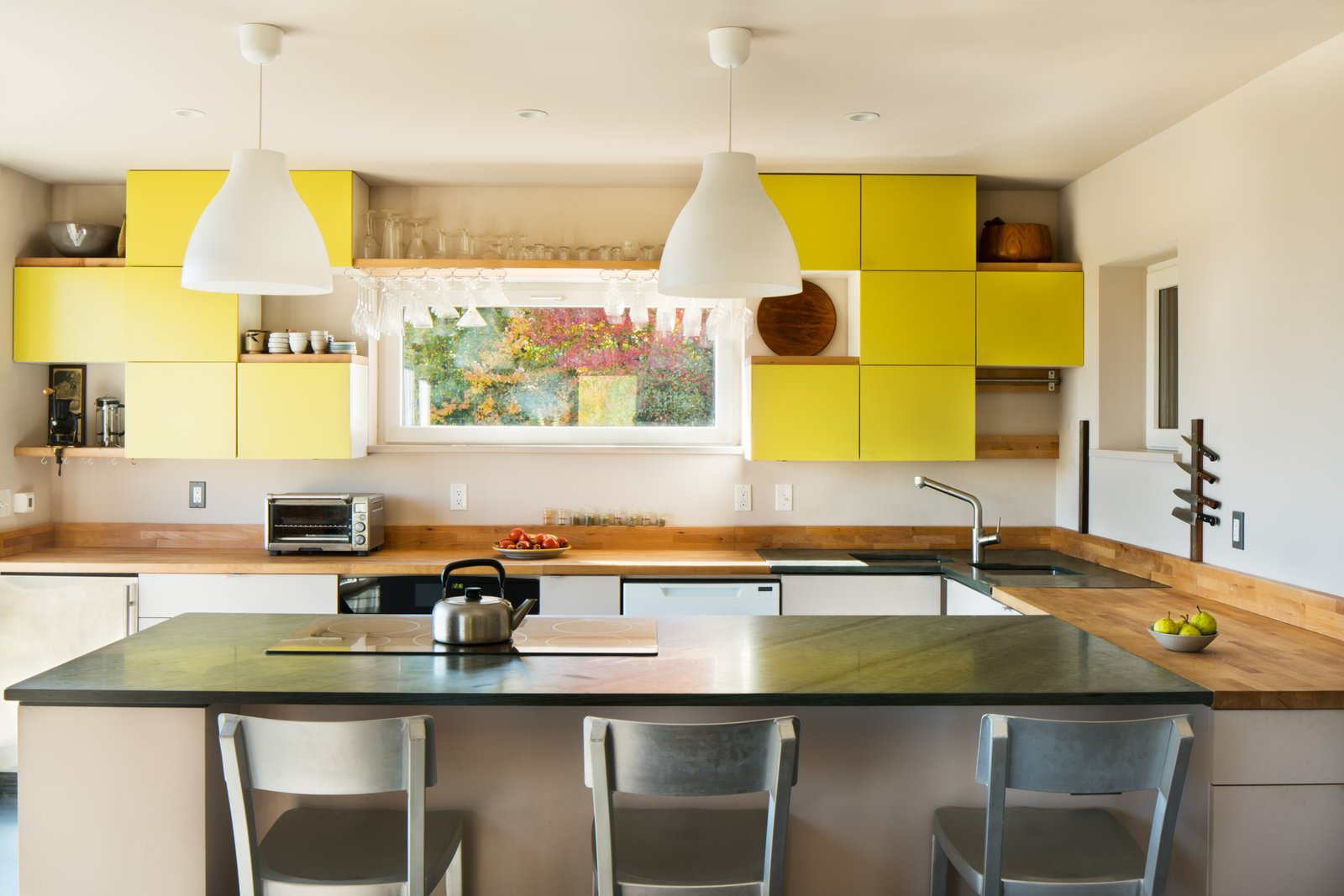 Tagged: Kitchen, Wood Counter, Colorful Cabinet, Undermount Sink, Cooktops, Recessed Lighting, Dishwasher, and Pendant Lighting.  Photo 3 of 10 in GO Home Takes the Passive House Approach to Prefab