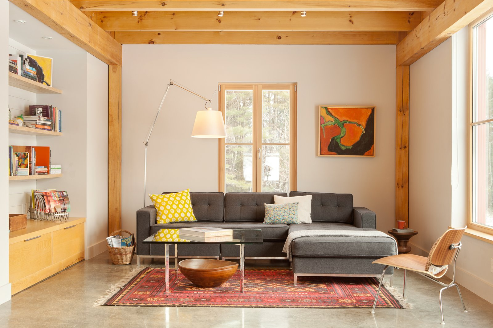Tagged: Living Room, Sectional, Coffee Tables, Chair, Shelves, Track Lighting, Concrete Floor, Rug Floor, Floor Lighting, Lamps, and End Tables.  Photo 6 of 10 in GO Home Takes the Passive House Approach to Prefab