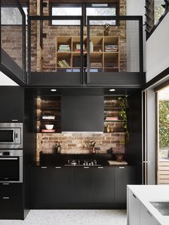 "Dwell's Top 10 Kitchens of 2017 - Photo 7 of 10 - With the addition of a striking, two-story ""living hub,"" architect Rebecca Caldwell of Maytree Studios adds the finishing touch to her brother's Sunshine Coast home in Queensland, Australia. The double-height, 1800-square-foot addition, as designed by Caldwell of Maytree Studios and built by her brother, hosts generous kitchen and living areas with ample connection to the outdoors, as well as an upper mezzanine floor that can be flexed for work or play."