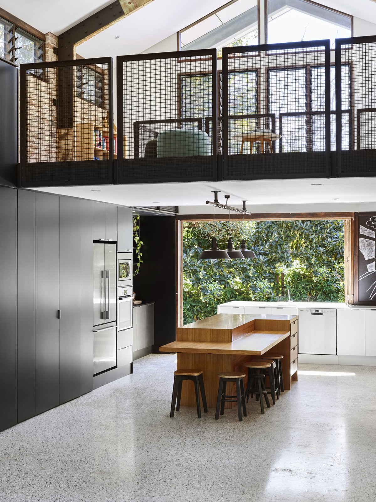 Tagged: Kitchen, Engineered Quartz, Pendant, Terrazzo, Wood, Track, Dishwasher, Refrigerator, Wall Oven, and Microwave.  Best Kitchen Refrigerator Wall Oven Microwave Pendant Photos from A Brisbane Architect Designs a Light-Filled Addition For Her Brother