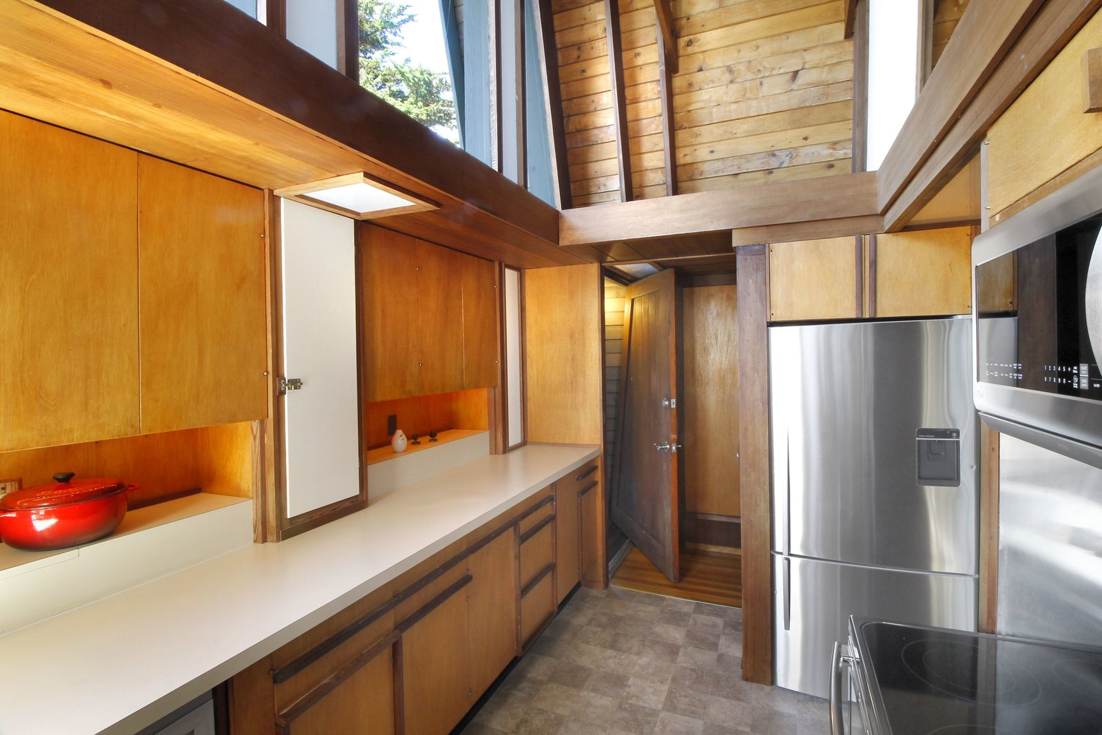Tagged: Kitchen, Wood Cabinet, Refrigerator, Microwave, Cooktops, and Wood Backsplashe.  Photo 8 of 11 in A Perfectly Preserved Midcentury Pad in Northern California Asks $1.975M