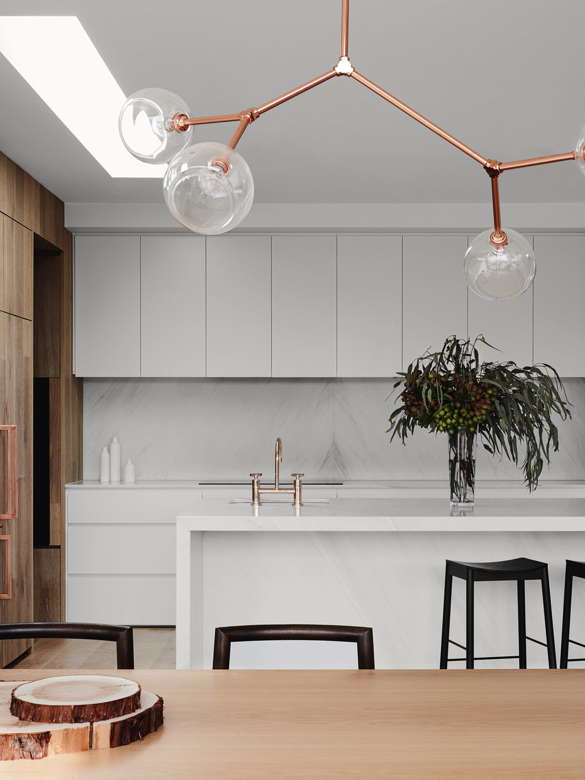 Tagged: Marble, Range, White, Marble, Light Hardwood, Pendant, Drop In, Windows, and Skylight.  Best Windows Light Hardwood Pendant Photos from A Run-Down Melbourne Bungalow's Makeover Embraces Light and Family Life