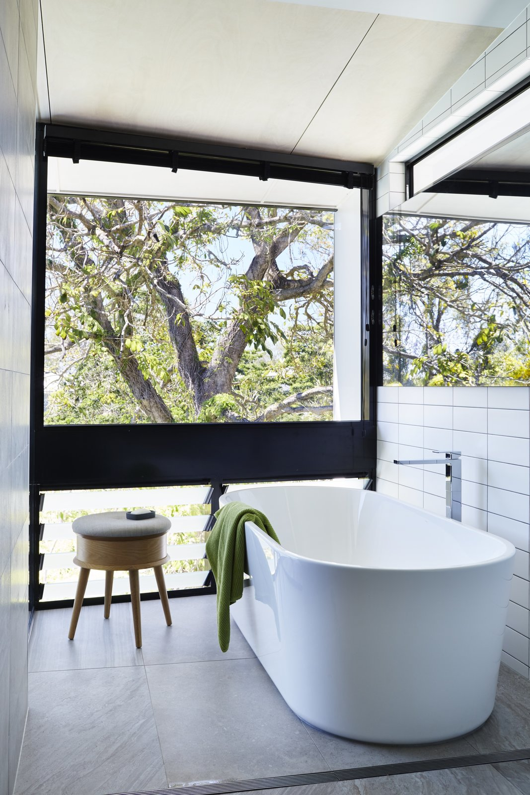Tagged: Bath Room, Freestanding Tub, Soaking Tub, and Subway Tile Wall. An Edgy Slatted Facade Conceals a Striking Indoor/Outdoor Home in Brisbane - Photo 6 of 12