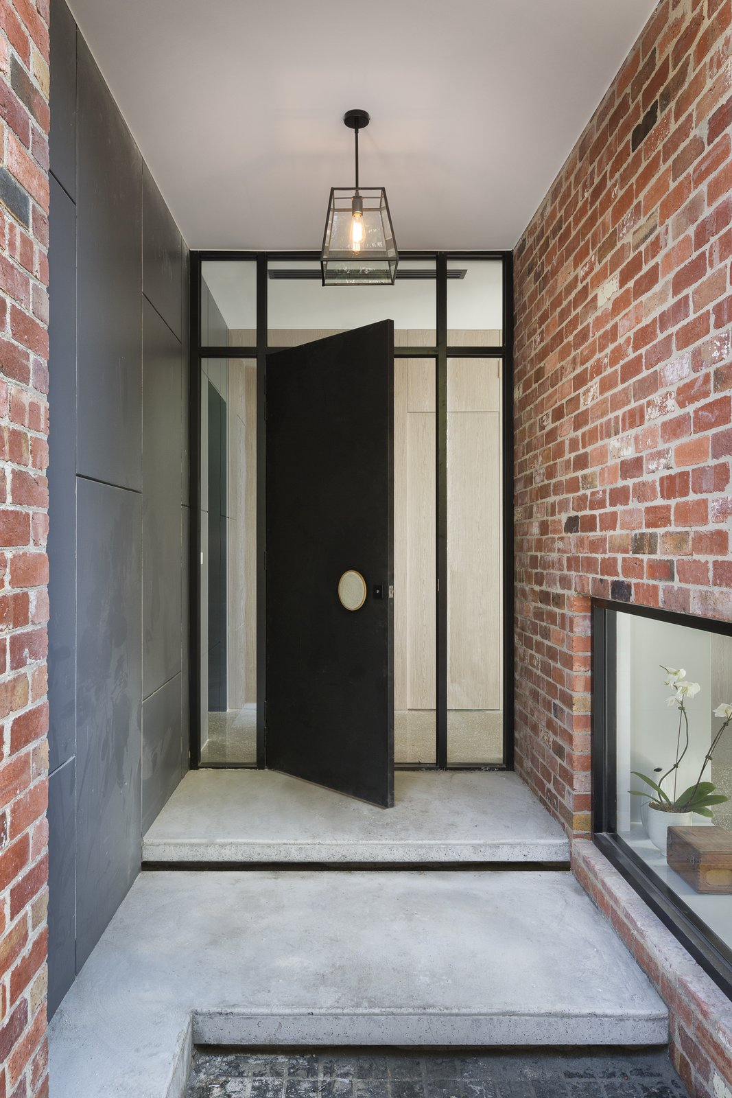 Tagged: Doors, Exterior, Metal, and Swing.  Best Doors Photos from A Progressive Melbourne Development Company Helps Facilitate an Exquisite Home Renovation