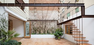 A Dramatic Apartment Renovation in Barcelona Features Salvaged Tile and Brick - Photo 12 of 13 -