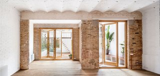 A Dramatic Apartment Renovation in Barcelona Features Salvaged Tile and Brick - Photo 2 of 13 -