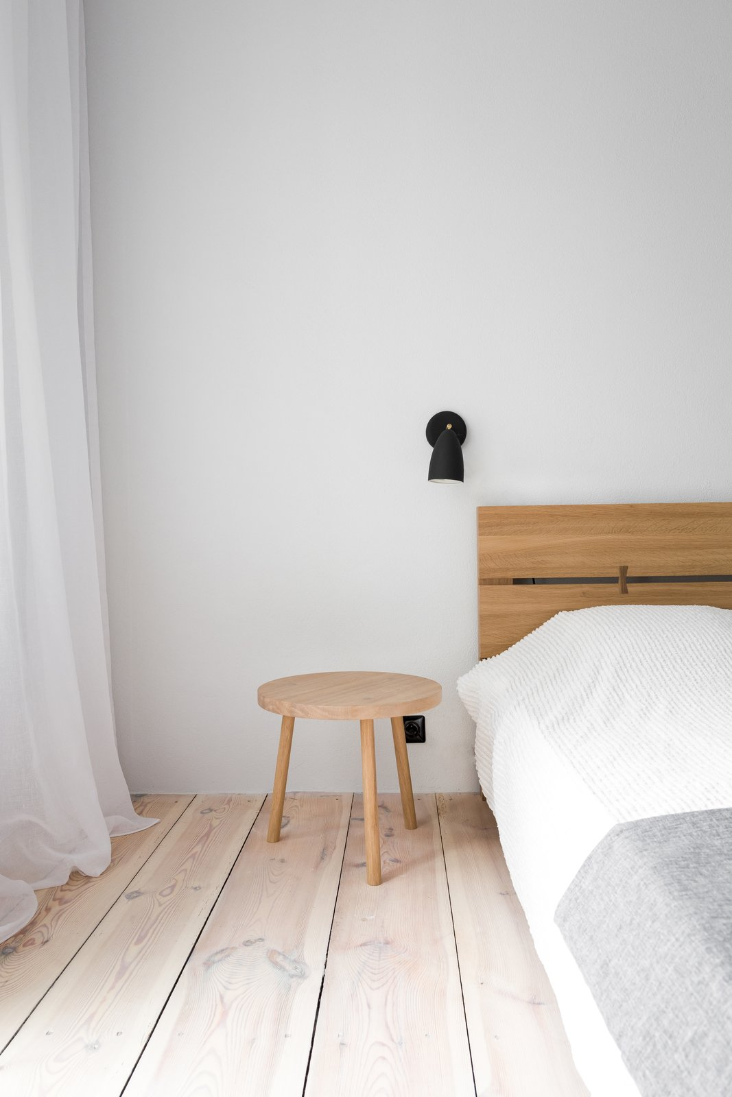 Tagged: Bedroom, Bed, Light Hardwood Floor, and Night Stands.  Best Photos from A Holiday Apartment in Poland With the Perfect Mix of Vintage and Custom Furniture
