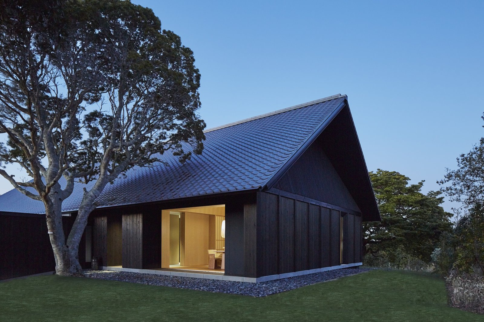 Tagged: Exterior, House, Tile Roof Material, and Wood Siding Material.  Photo 2 of 10 in A Sleek Resort in a Japanese National Park Reinterprets Tradition