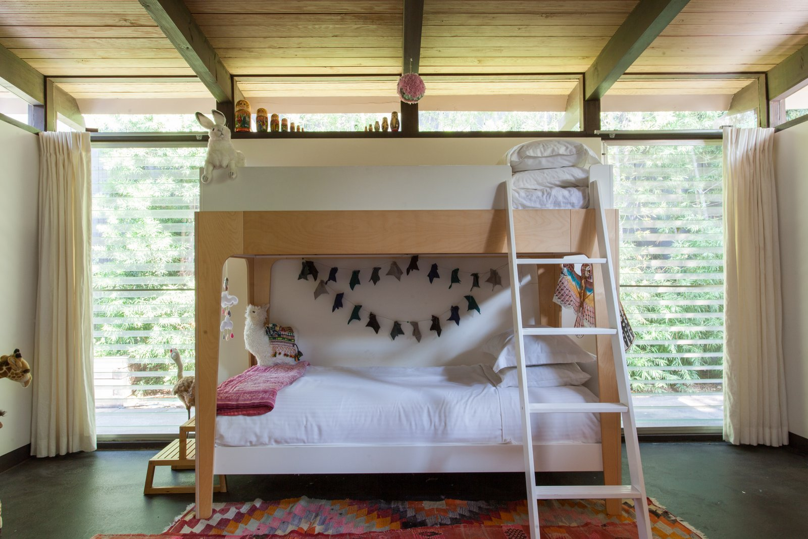 Tagged: Kids, Bunks, Bedroom, Rug, Pre-Teen, and Neutral.  Best Kids Photos from Hole Up in This Quintessential Midcentury Modern Rental in Hollywood