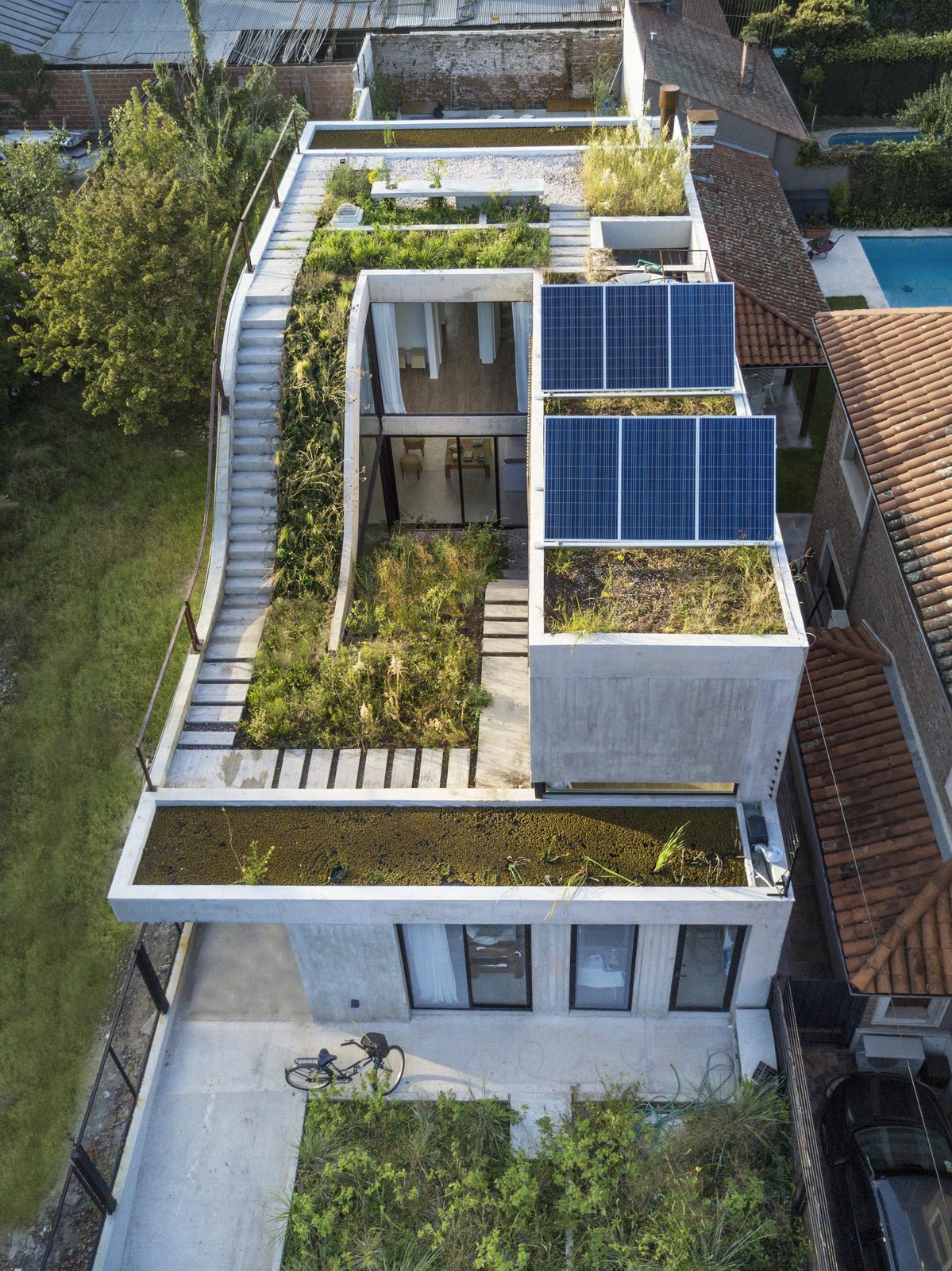 A Gardener's Home in Argentina Boasts Flowing Green Spaces
