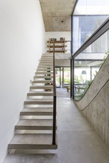 A Gardener's Home in Argentina Boasts Flowing Green Spaces - Photo 3 of 13 - A floating staircase offers views into the back garden.