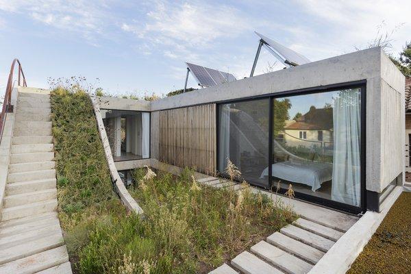 The first floor with bedrooms overlooking rooftop gardens.
