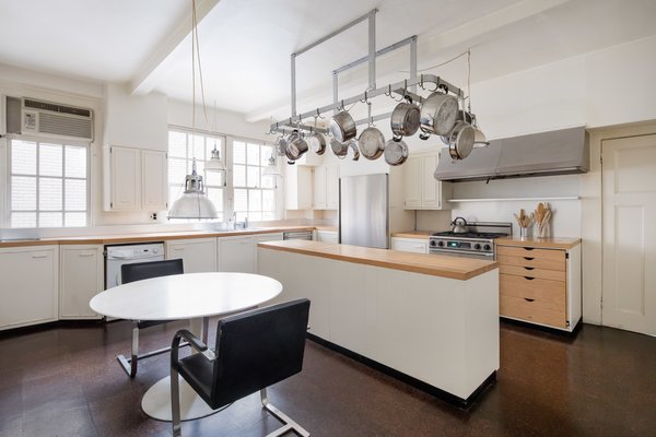The eat-in kitchen with butcher block counters.