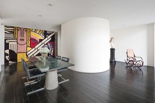 Legendary Designers Massimo and Lella Vignelli's New York Duplex Is Listed at $6.5M - Photo 5 of 8 - A close-up of the dining room with large-scale art