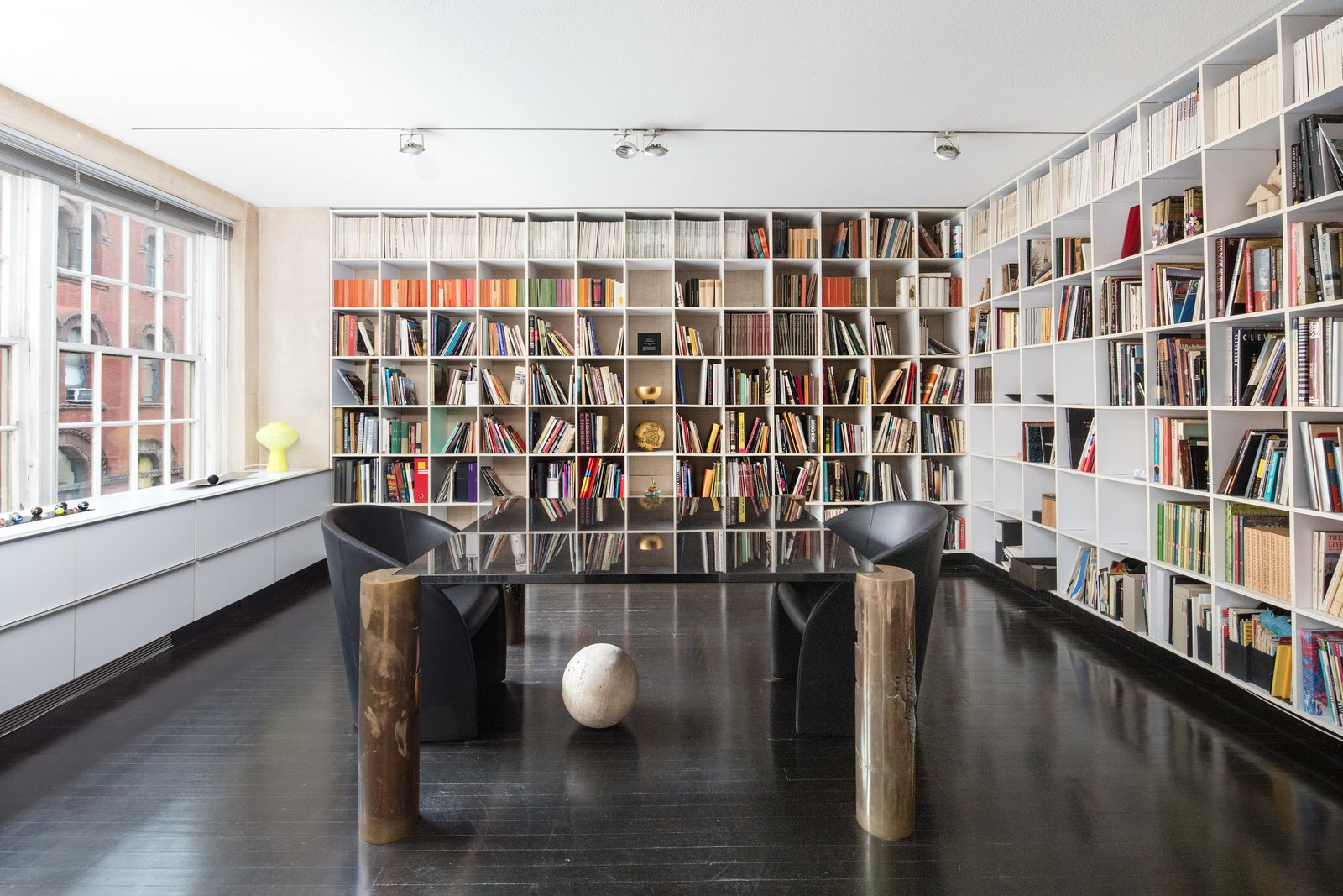 Lella Vignelli's office is lined with bookshelves. She designed the desk with legs fashioned by sculptor Arnaldo Pomodoro. The couple were known to host many cultural luminaries in the apartment, including Pomodoro and philosopher Umberto Eco.