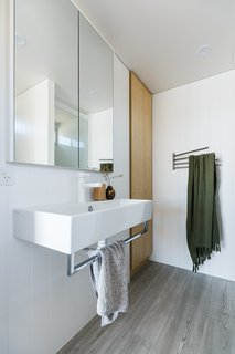 """Life in This Renovated Houseboat Would Be But a Dream - Photo 10 of 13 - """"Laminex Aquapanel was selected in wet areas to meet the weight restriction and potential of cracking tiles,"""" says Harry."""