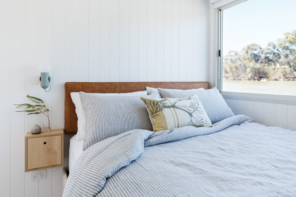 Bedrooms capitalize on river views and built-in storage.