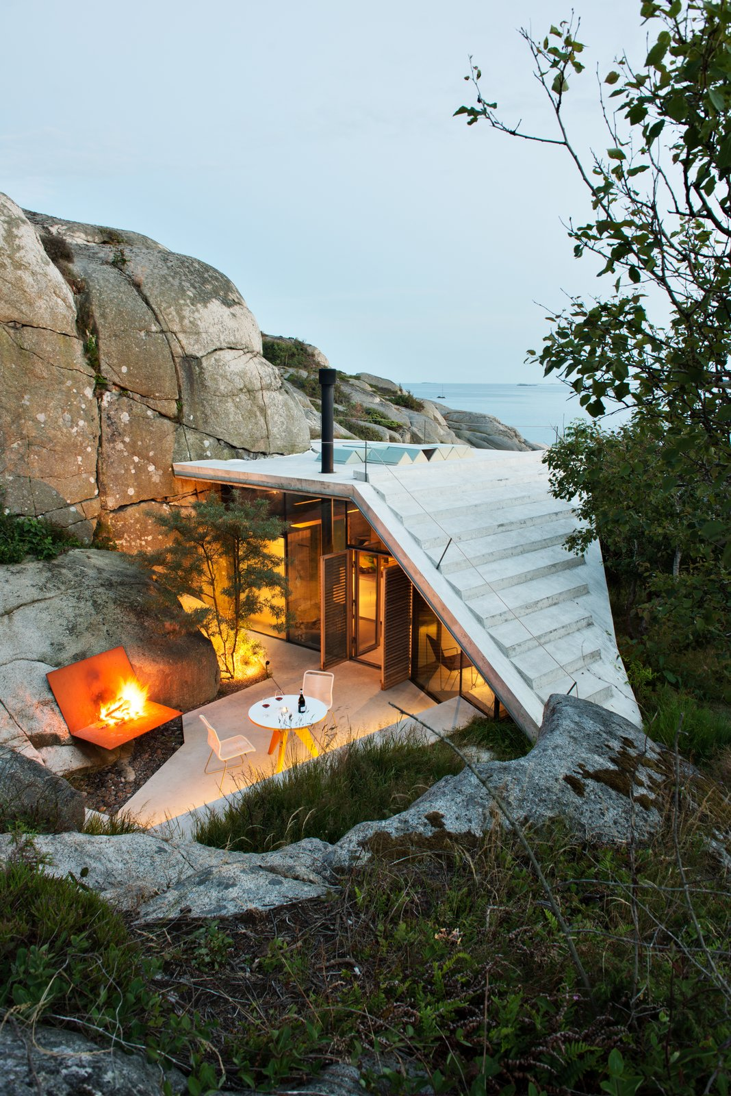 """Lung Hagem Arkitekter said: """"The roof is executed in 270mm thick reinforced concrete with 20mm VIP insulation underneath. The concrete itself is water resistant, thus no additional roofing materials are required. As a result, the roof is a smooth white surface creating a dialogue with the rocky landscape, and giving the cabin its distinctive character."""""""