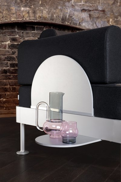 """The side table can be used """"as a cocktail tray on a chaise lounge, a bed-side table on the humble single bed, or a convenient resting spot aside a sofa for your mobile apparatus,"""" writes the brand."""