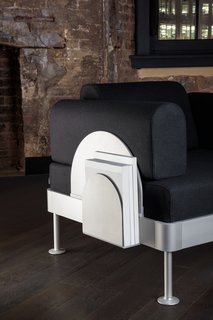 Tom Dixon's New Furniture Collaboration With IKEA Warmly Welcomes Hacks - Photo 4 of 6 - The furniture also comes with a sleek, scalloped magazine rack.