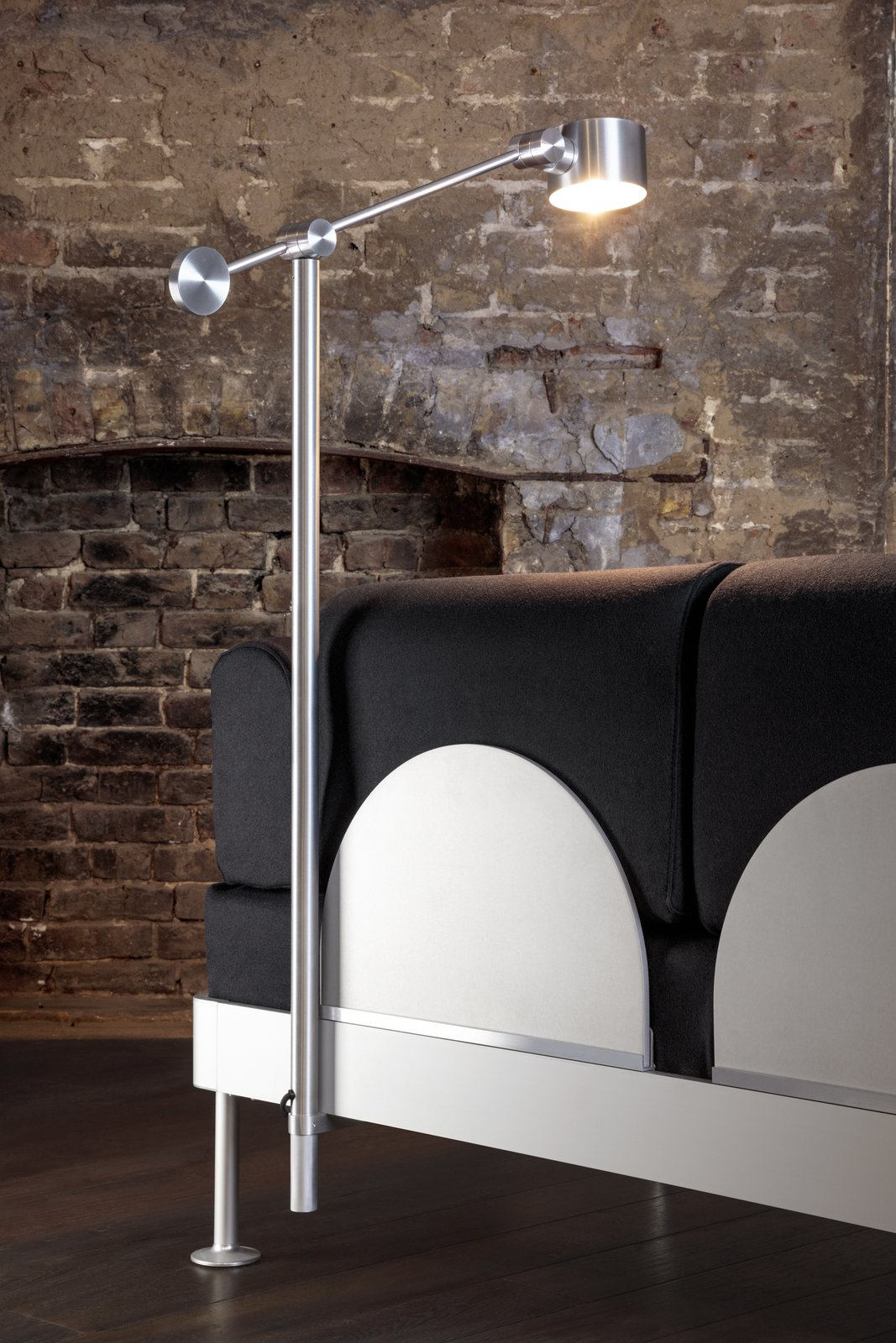 The detachable BOOM light takes its inspiration from machinist lamps and back panels made of polished and anodised aluminum provide back support.