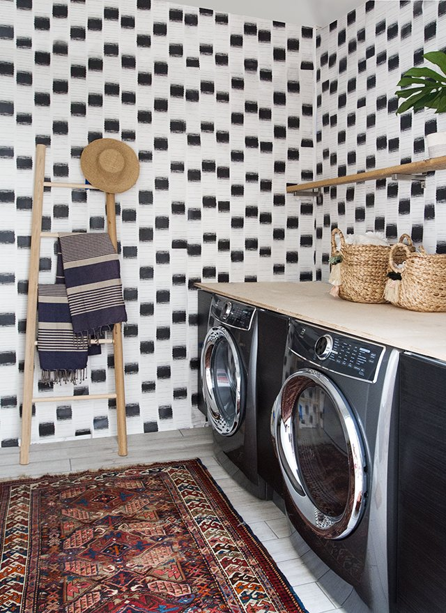 The laundry room features custom wallpaper designed by Samuel. Tagged: Laundry, Side-by-Side, Wood, and Open.  Best Laundry Photos from A Chic, Renovated A-Frame in Palm Springs Asks $535K