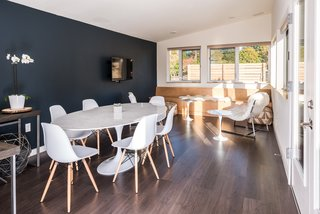 Serenity Awaits at These Prefab Cabin Rentals on Vashon Island - Photo 5 of 6 - A Saarinen table and Eames chairs in the Public House are perfect for gathering morning or night.