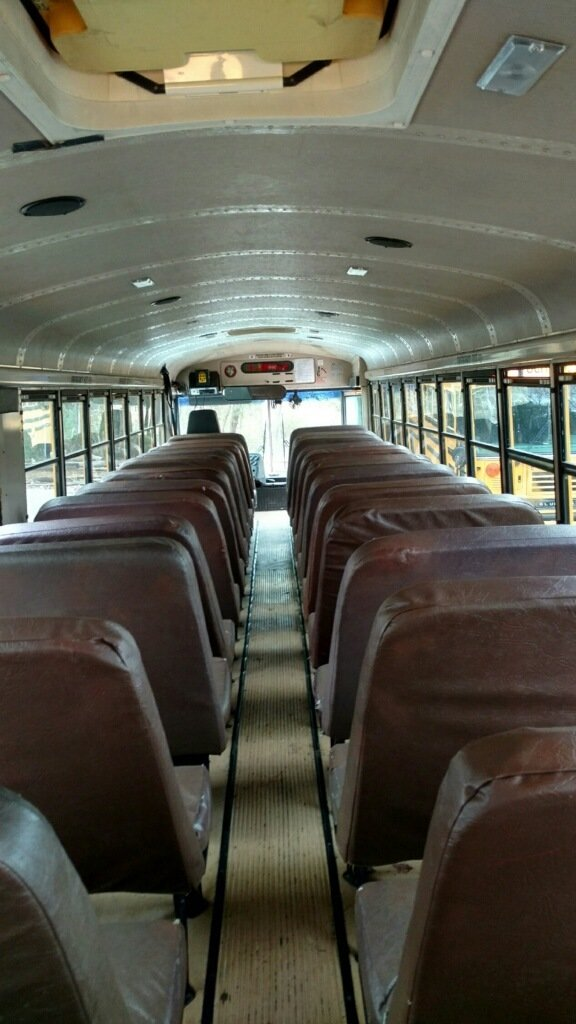 Looking toward the driver's seat, with all of the bus seats still intact.