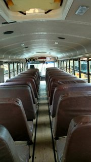 """A Couple Convert An Old School Bus Into A Light and Efficient Family Home - Photo 1 of 12 - When the Mayes Team found """"Skoolie,"""" it still had the bus seats intact."""
