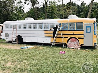 A Couple Convert An Old School Bus Into A Light and Efficient Family Home - Photo 4 of 12 - They opted for a clean, crisp shade of white for the exterior of the bus.