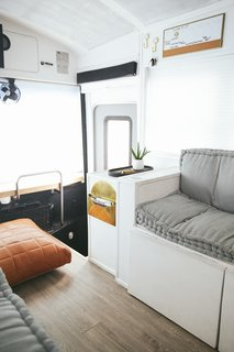 A Couple Convert An Old School Bus Into A Light and Efficient Family Home - Photo 6 of 12 - Here is a close-up view of the entry. Note the organization tricks for a small space, such as the tray, wall hooks, message board, and paper catchall.