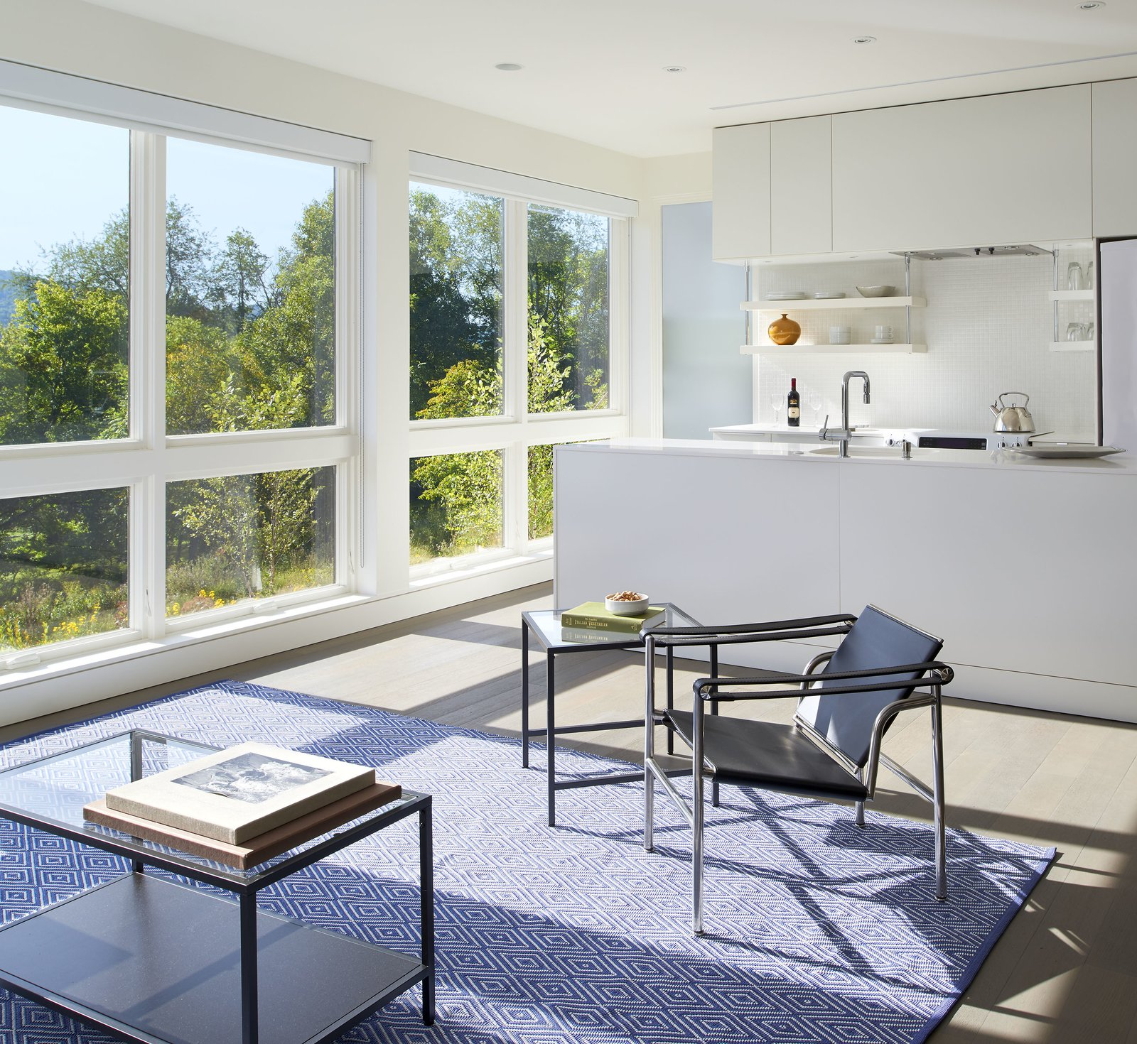 """In the ground floor apartment, """"there are picture windows with operable awning [windows] below, which provide the cross ventilation,"""" said Wiedemann. Tagged: Windows, Awning, and Picture.  Best Windows Photos from A Modern Farmhouse Blends Community-Minded Living With the Country Landscape"""