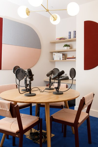 The podcast room includes the Alto Compass chandelier from Cedar & Moss.