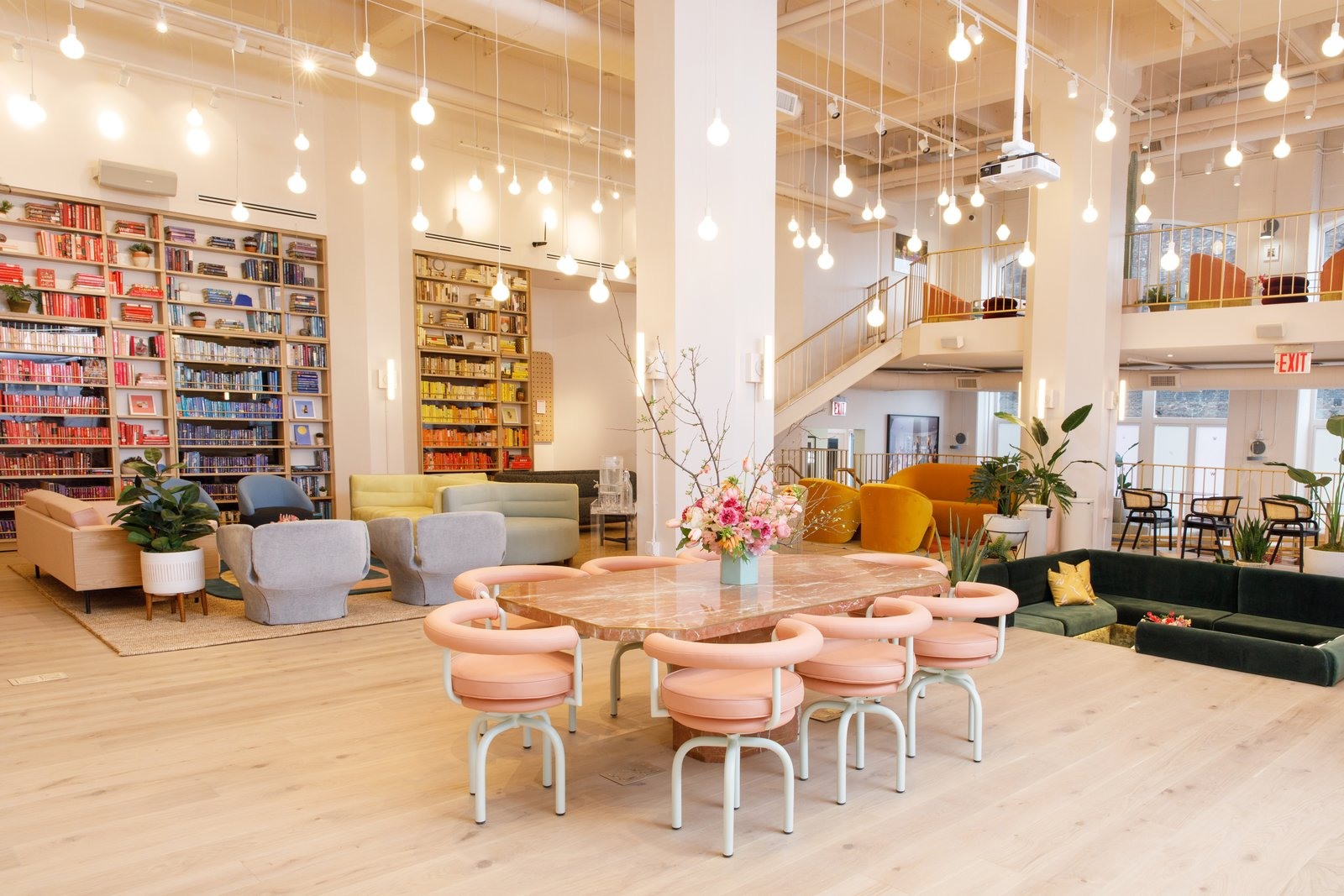 A dramatic pink granite table provides a central meeting spot. Tagged: Office, Chair, Bookcase, Library, Study, Light Hardwood, Shelves, and Rug.  Best Office Photos from 10 Dwell Projects That Were Proudly Designed by Women
