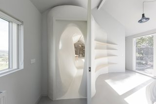 This Renovated Scottish Farmhouse With Sinuous Interior Walls Is a Jaw-Dropper - Photo 7 of 8 - This shows how the freeform wall surfaces are juxtaposed against the more crisp and square geometries of doors and windows.