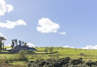 This Renovated Scottish Farmhouse With Sinuous Interior Walls Is a Jaw-Dropper - Photo 8 of 8 - The renovated home is nestled in its country setting with distant views into two valleys.
