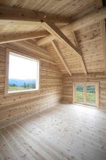 This Astounding Cabin in Norway Is a Patchwork of Different Materials - Photo 6 of 7 - In the fourth section of the cabin, there's a large north-facing window for observing the Northern Lights.