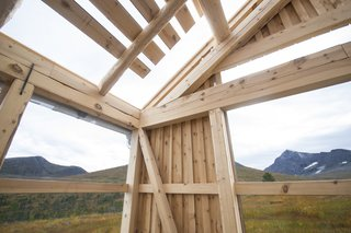 This Astounding Cabin in Norway Is a Patchwork of Different Materials - Photo 2 of 7 - In the garage, wooden joints are exposed, and the peak of Ryssdalsnebba can be seen to the south.